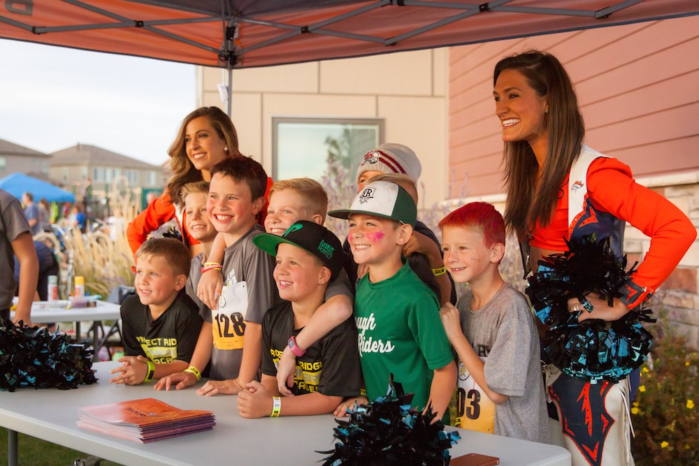 PRA Students getting pictures with Broncos Cheerleaders