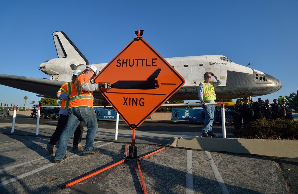 Shuttle Crossing sign in front of Space Shuttle Endeavour