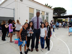 Assistant Principal Richard Waters greets students on the first day of school at Hawthorne.