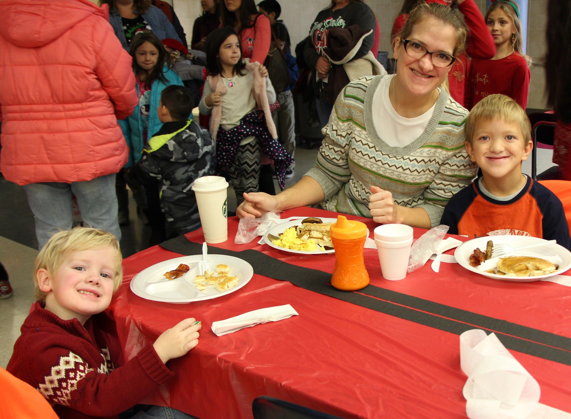 Families enjoy pancake breakfast with santa