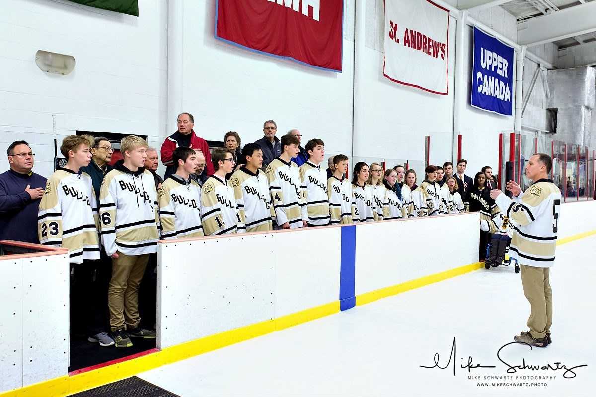 Chorus at Salute to Service Ice Hockey Game