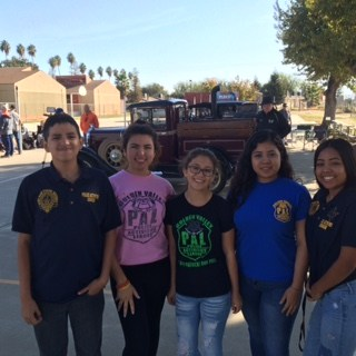 Students and Officer Money volunteering at Dust Bowl Days.
