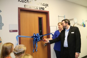 Mr. and Mrs. Turnage cutting the ribbon.jpg