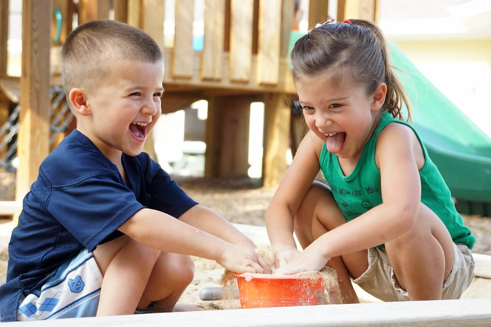 Two Kids Playing in Sand