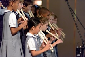 A group of students playing the recorder