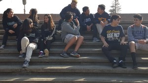 students sitting on steps at school