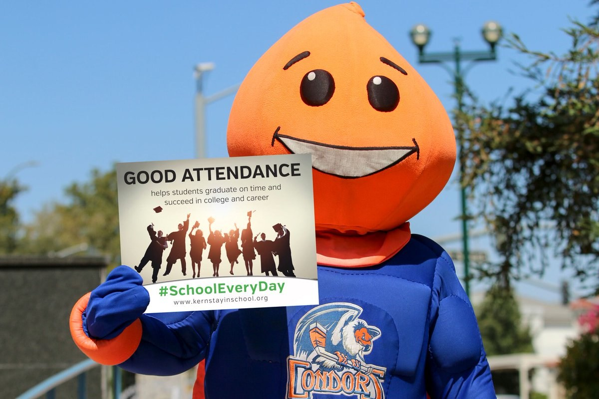 Hockey Mascot holding a chronic absence sign