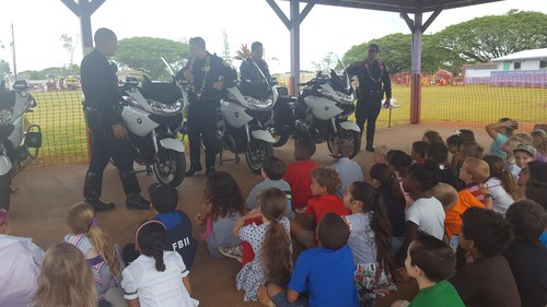 Solo Bike Officers from the Honolulu Police Department let students sit on their motorcycles. The children enjoyed themselves!