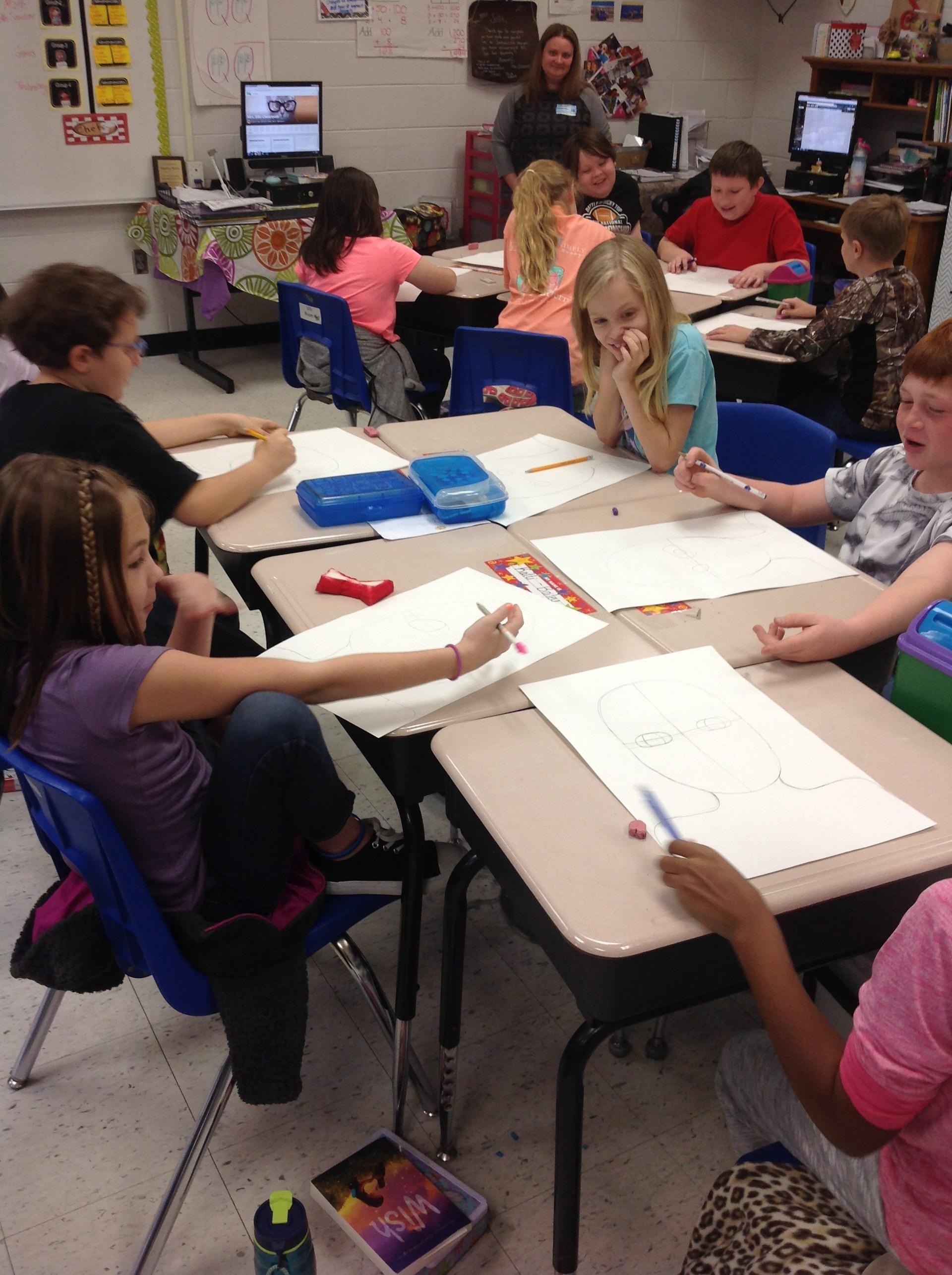 Kalli's group working on their portraits.