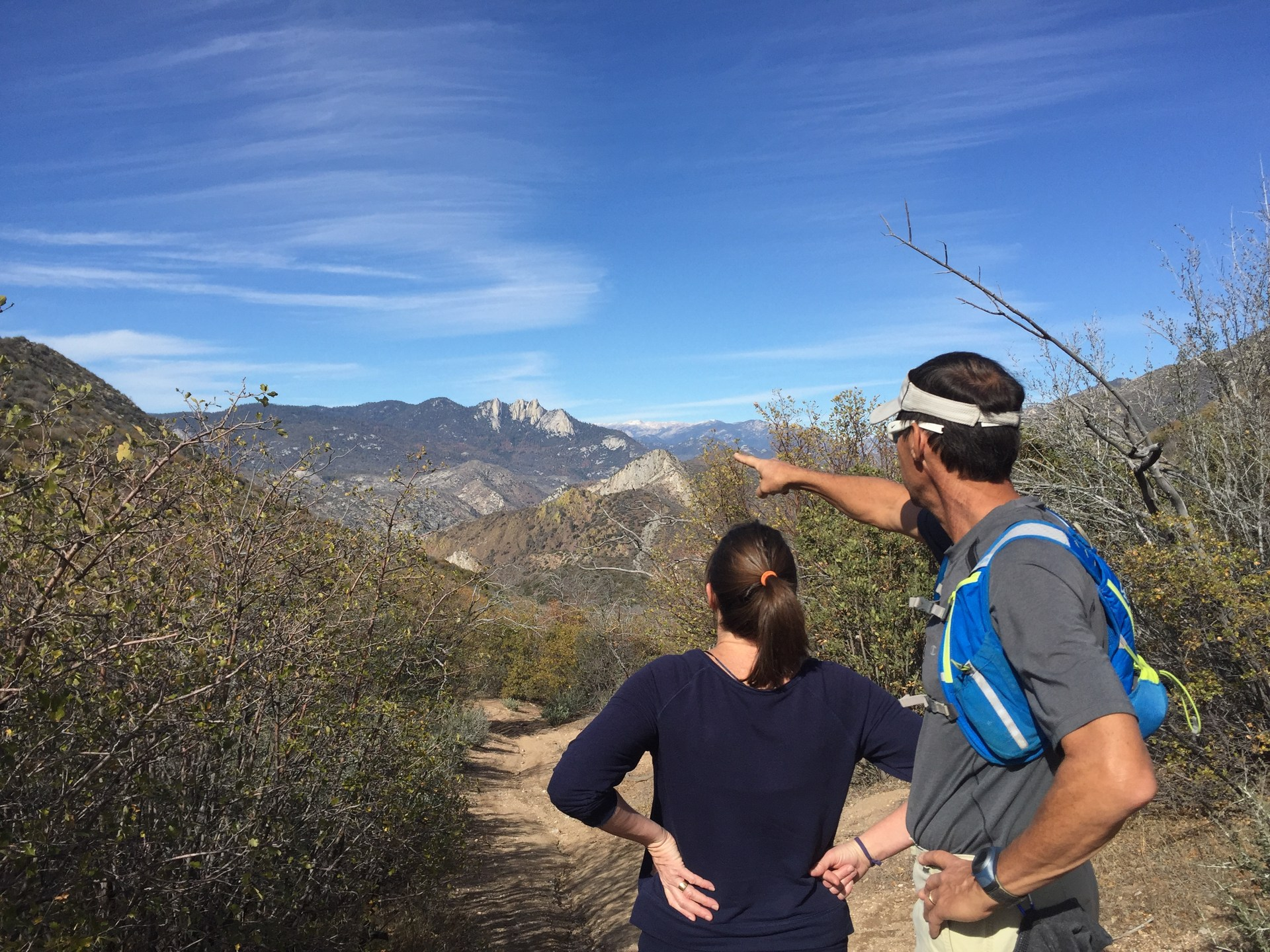 Pointing our the vistas during a hike.