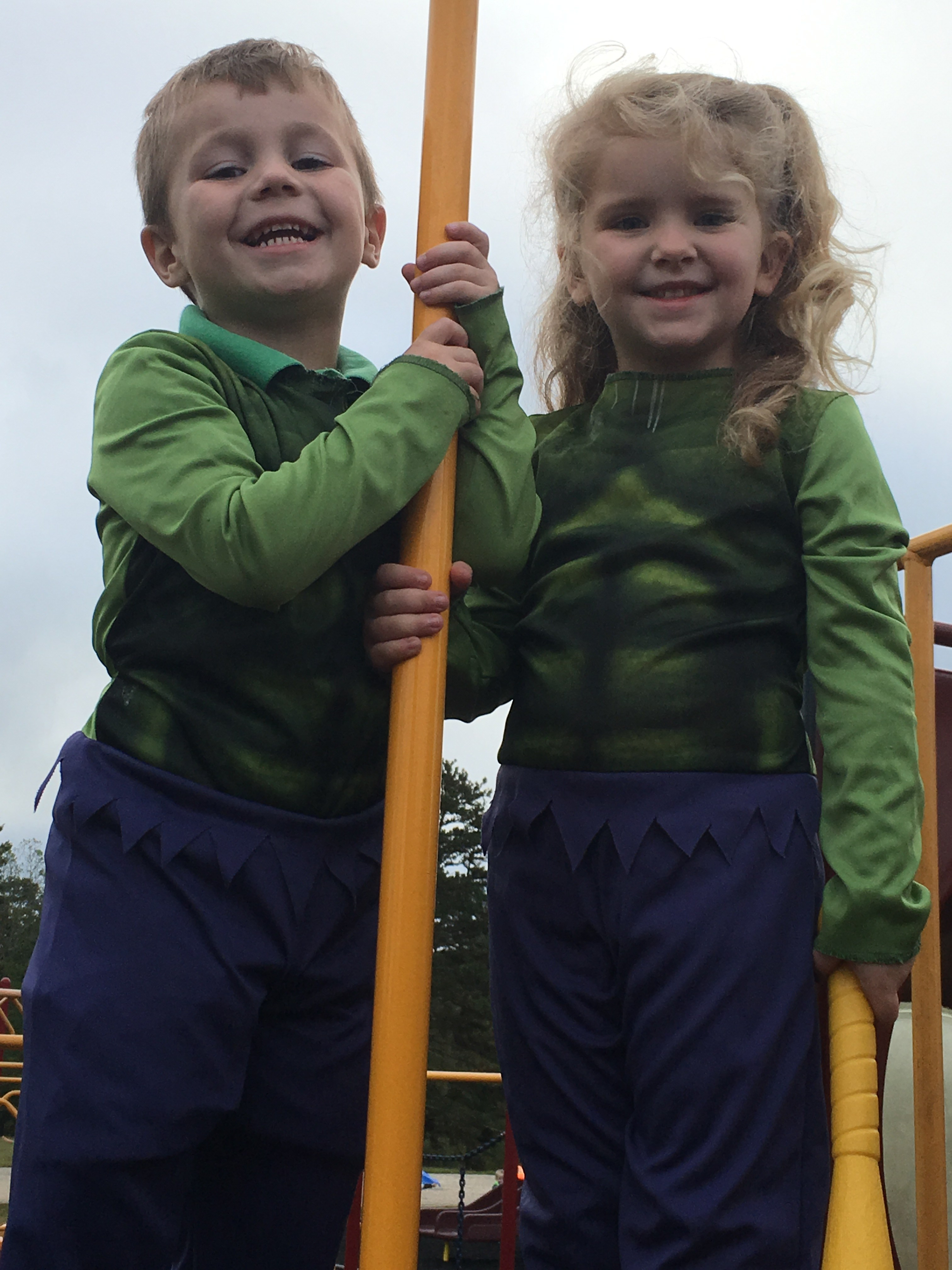 two students dressed as the hulk on the playground