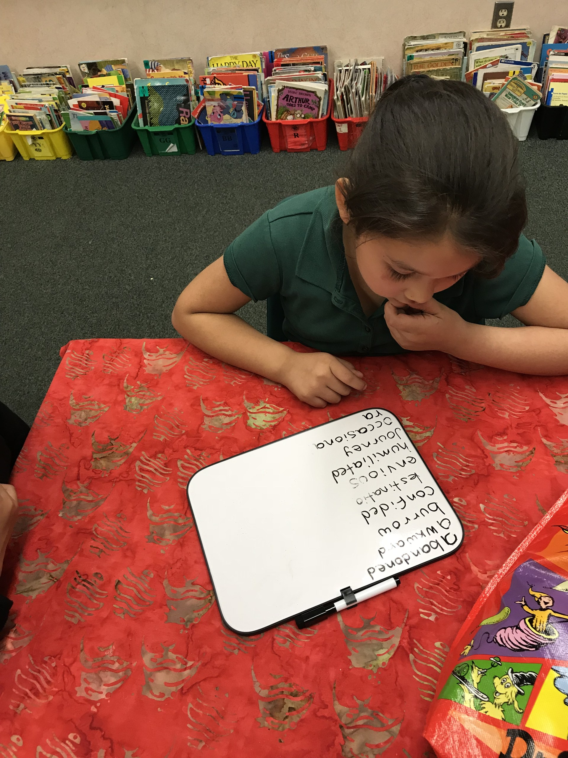 student working on literacy skills
