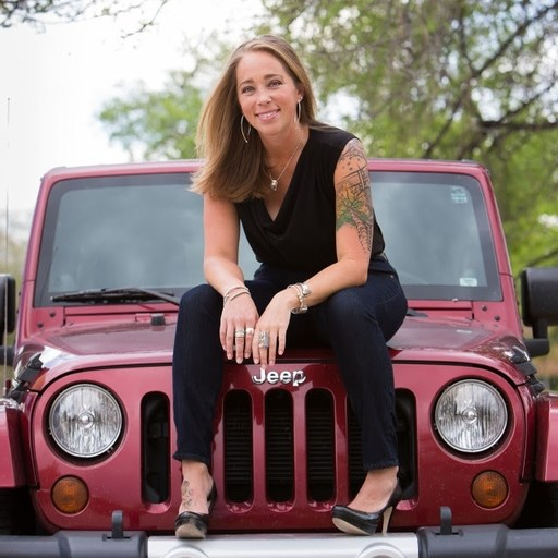 Jamie Rayne Cochran sitting on a Jeep