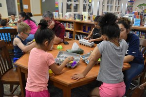 Families working with kids in the library.