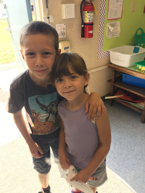 Big brother with little sister at the Kindergarten Tea