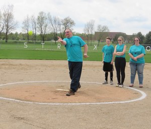 Brian Appel throws out a first pitch.