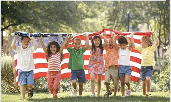 children holding the American flag