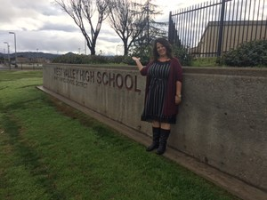 Christina Phipps in front of the West Valley High School sign.