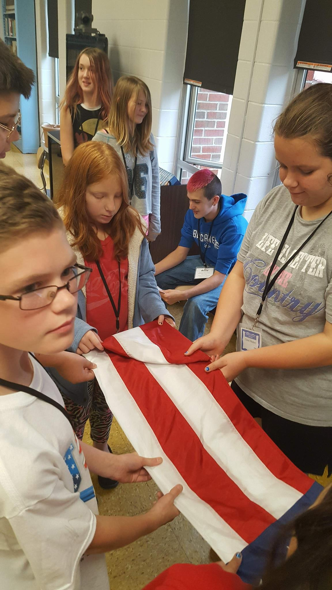 Veterans teaching students to fold the American flag