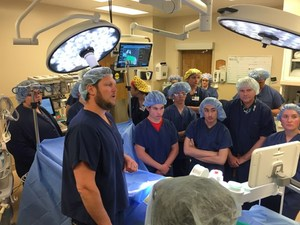 Students and a doctor in a surgery room