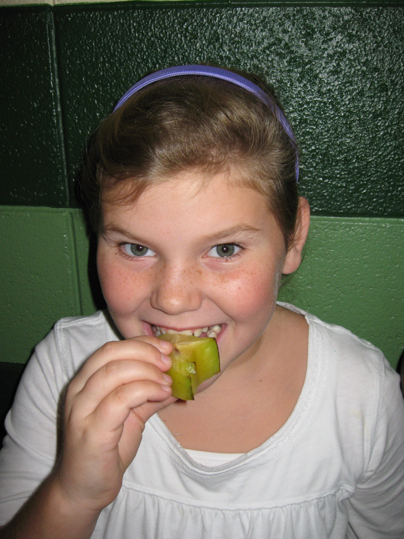 Student eating fruit.