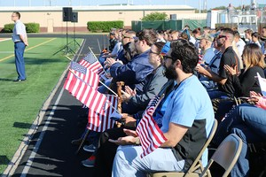 People participating in the Veterans Day observance ceremonies at Bulldog Stadium