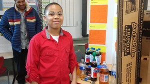 4th Grader displaying his Science Project