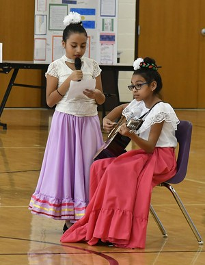 Two students perform a song at Alvarado Intermediate School's Multicultural Night.