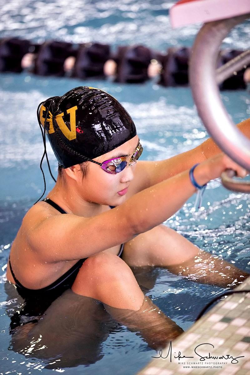 CHS girls swimming backstroker waits at starting block for race to begin