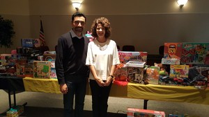 Superintendent in front of table with donated toys