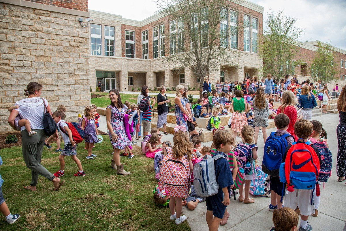 University Park Elementary students and their parents gather in front of the new elementary campus for the first day of school
