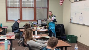 Mr. Belton teaches wearing a mermaid costume.