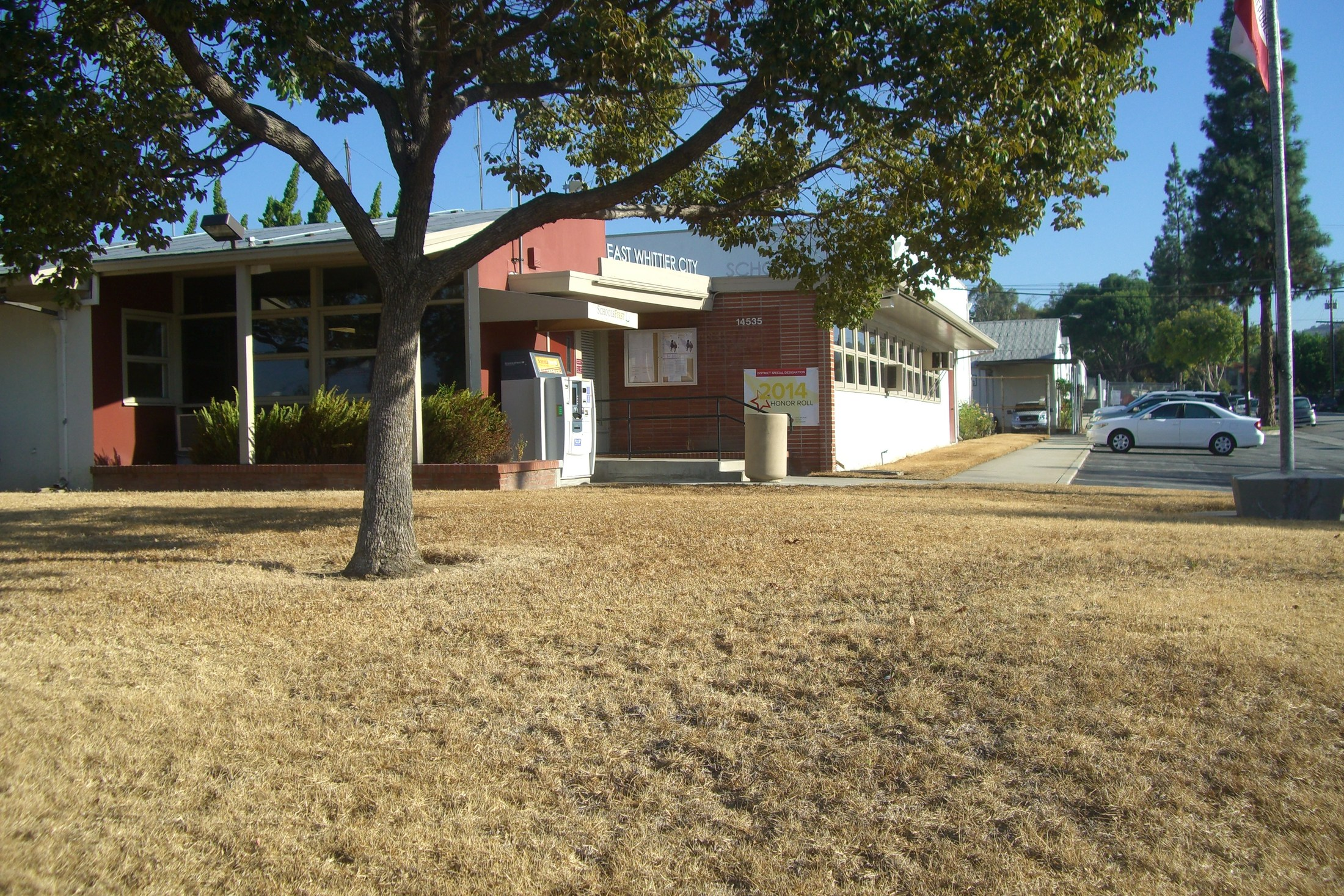 Brown grass in front of the district office