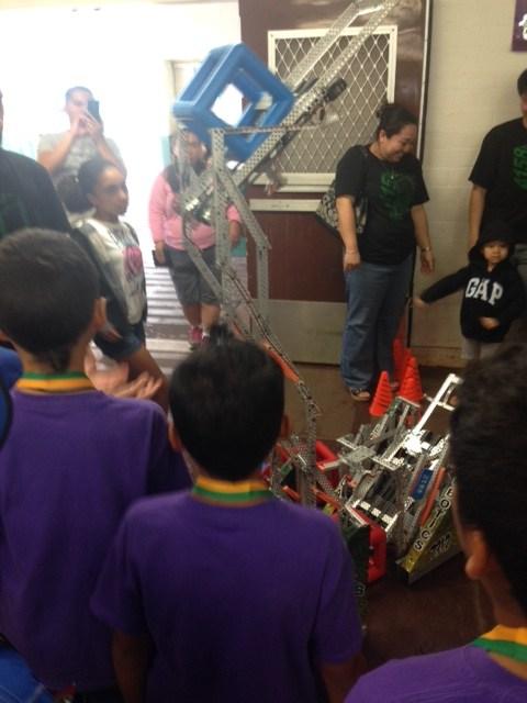 Students using robotics device