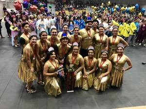Group picture of the colorguard in costume after the competition