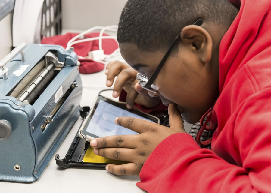 Student reading with iPad