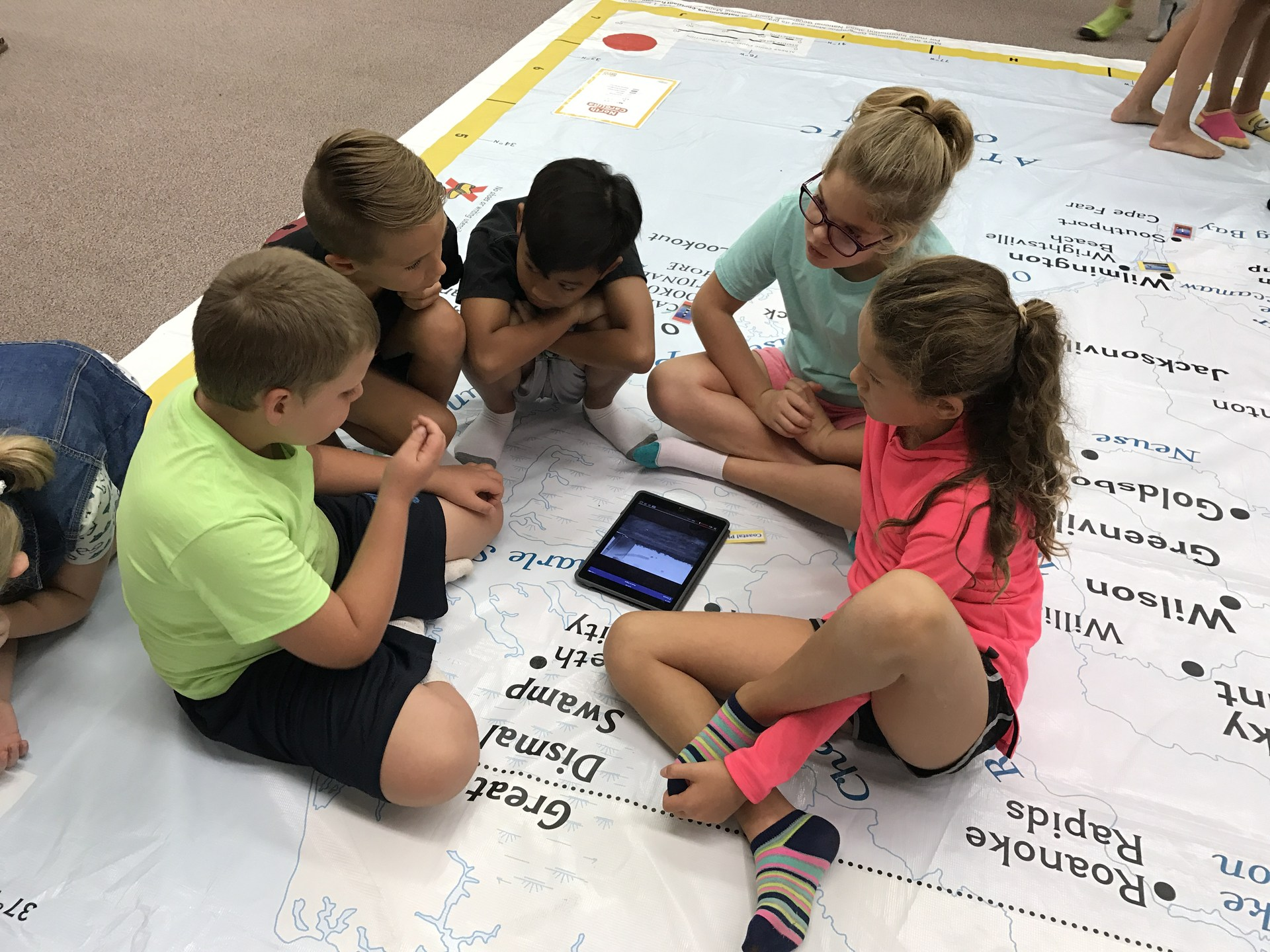 Students learning with the NC Giant Map