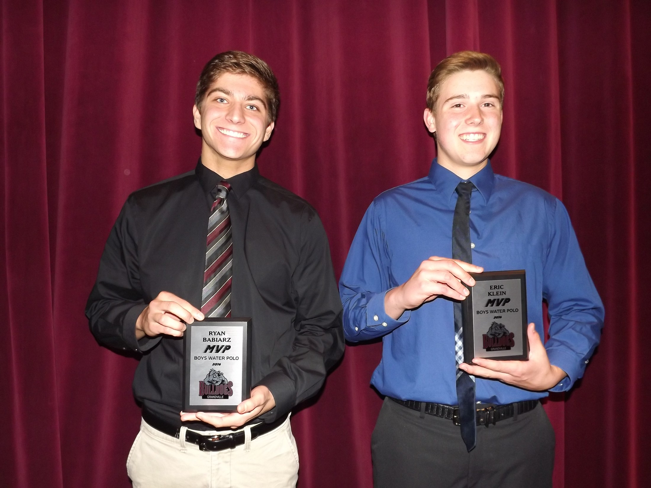 two boys with water polo mvp award