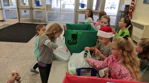 Student Council members empty donations into collection boxes.