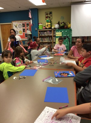 students working on craft in library.