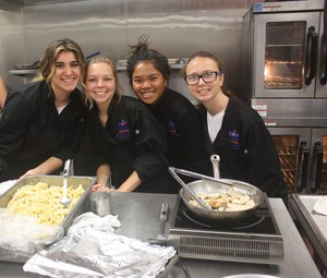 students preparing lunch for staff