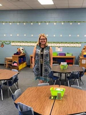 Teacher stands in her classroom.