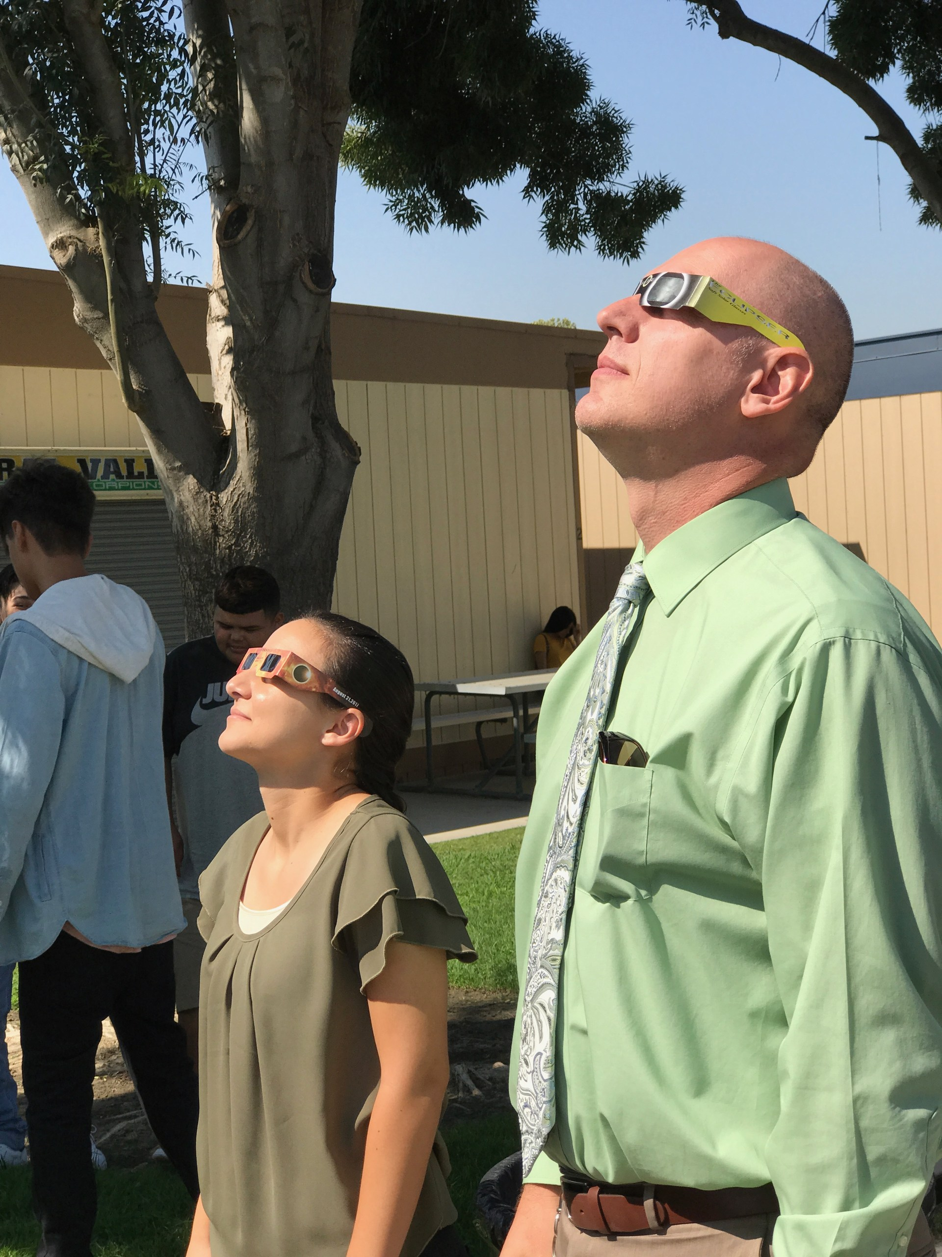 Teachers observe the solar eclipse
