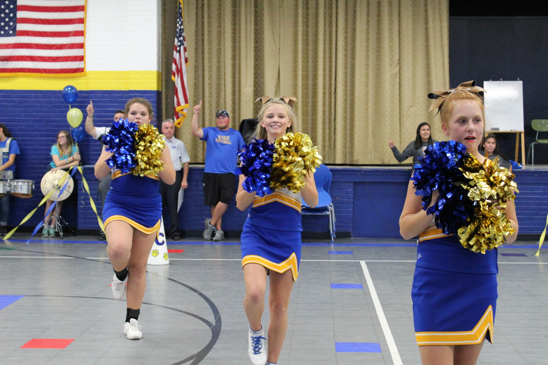 Jr. High Cheerleaders doing the school song