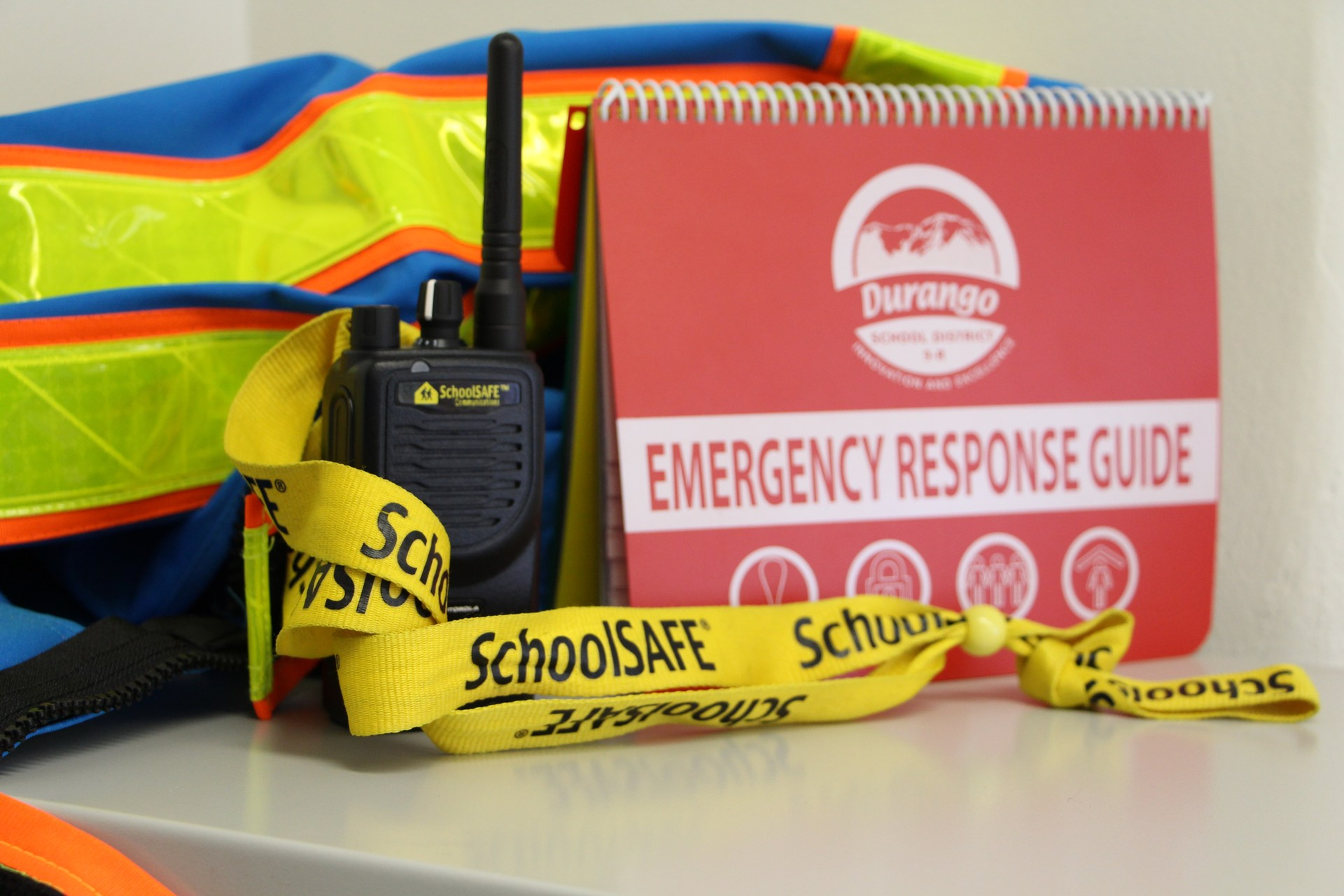 Image of safety items, including radio, vest and EOP guide