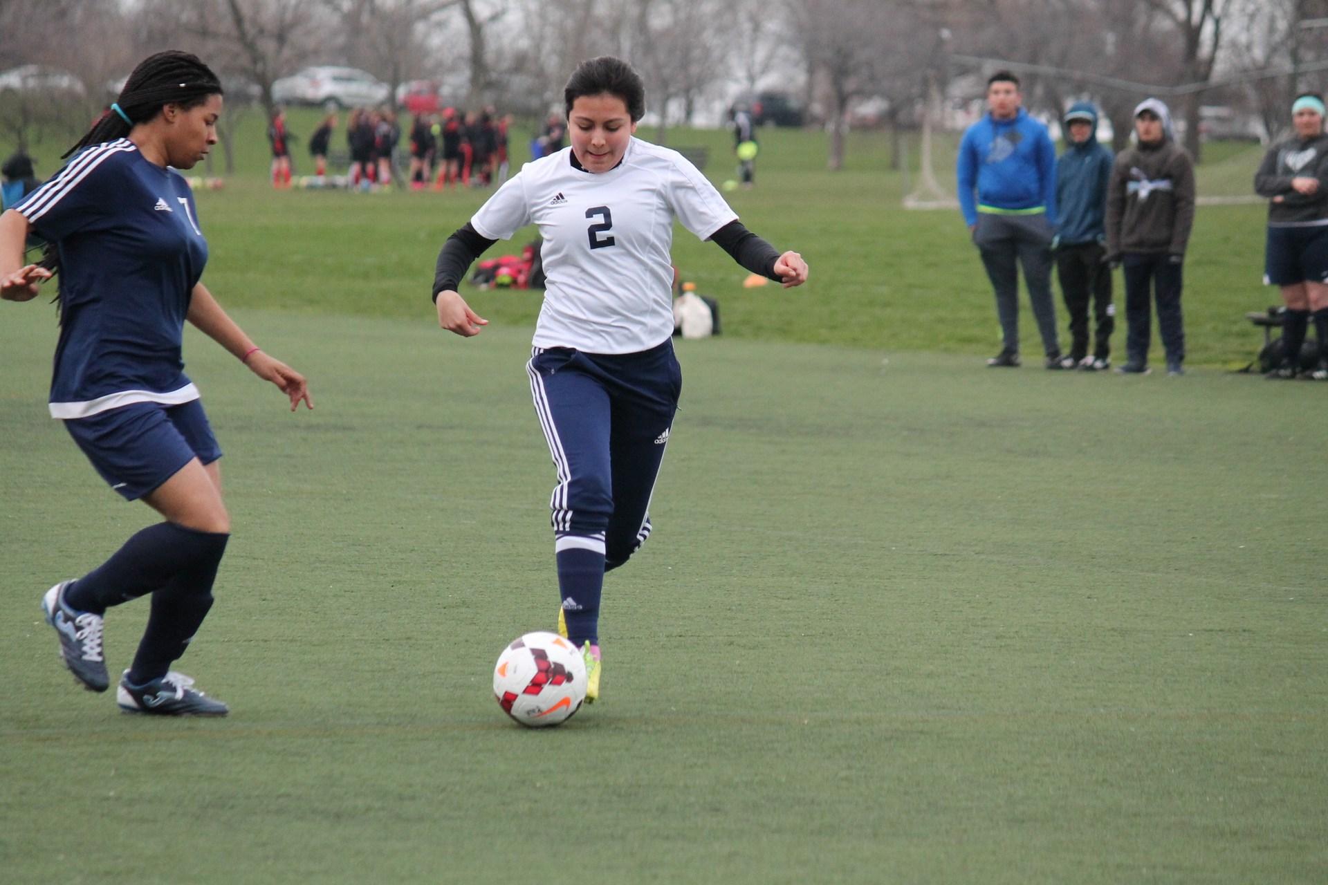 Rickover cadet kicking a soccer ball
