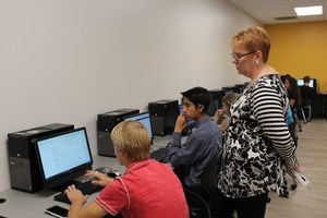 counselor helping students in computer lab