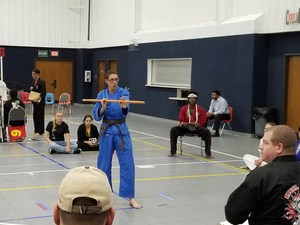 Martial Arts Student holding stick during tournament