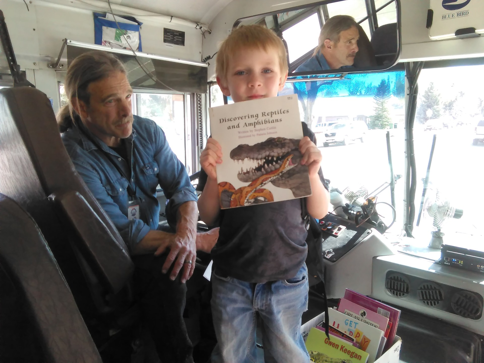 Bus driver Jonas Grushkin encourages students to read on the bus with his Books On Board