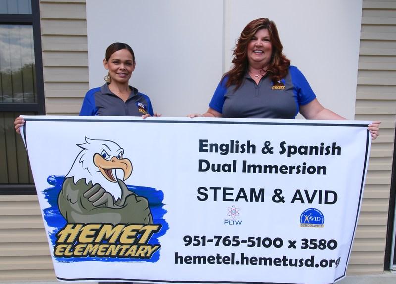 Melina Serna and Kristi Watson holding a Hemet Elementary banner
